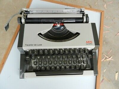 Vintage AEG OLYMPIA Portable Typewriter with Shell Case Lid