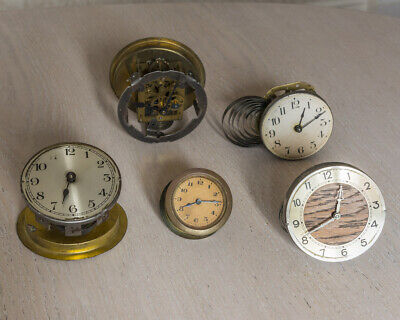 Five 1 day clock movements, spares or repair