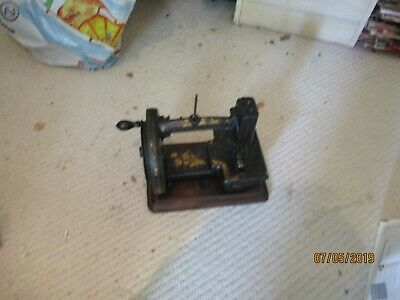 A small heavy Victorian Sewing Machine with shuttle