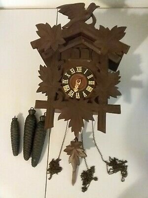 Antique Ed.Herr Sohne German cuckoo clock. Music box & bird and little man.