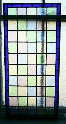 Beautiful Victorian design stained glass panel with deep blue border.