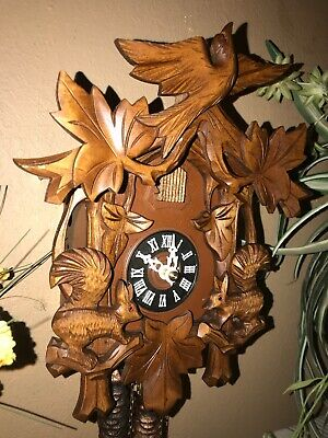 Beautiful German Black Forest Carved Squirrels Cuckoo Clock