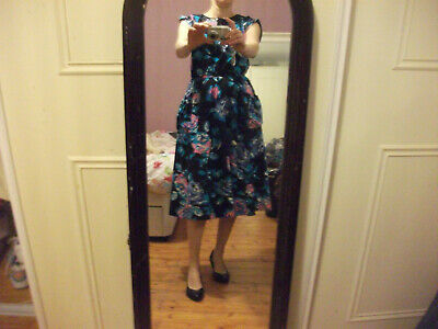 vintage 1980s does 1950s black floral midi teadress with pockets size 10/12