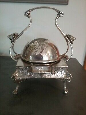 Victorian silverplate butter/caviar rolltop dish with cow finials.