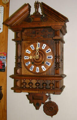 Old gothic black forest cuckoo clock, winding mechanism