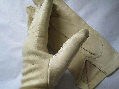 leather gloves top quality  still in tissue    old but unused  pale cream colour