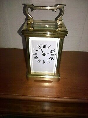 Superb brass cased striking carriage clock