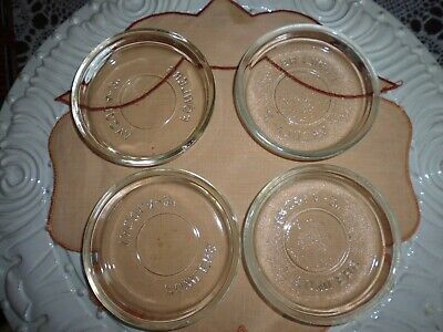 Fowlers glass lids -Four