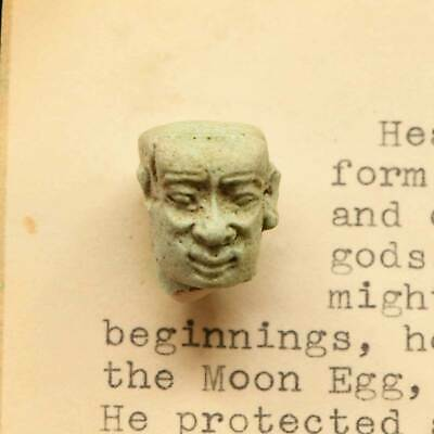 * An Egyptian Faience Amulet Head of the God Ptah-Sokar, 12th Dynasty, ca. 1900