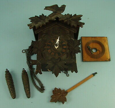 """Vtg Carved Wood Cuckoo Clock 11"""" Tall x 7"""" Long W/ Pendulum & Pine Cone Weights"""