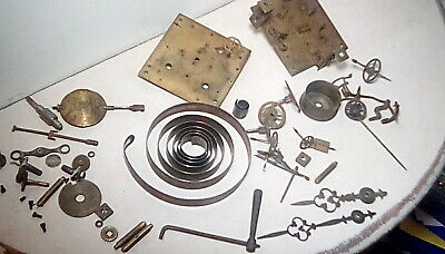 Old clock movement in pieces for spares or repair