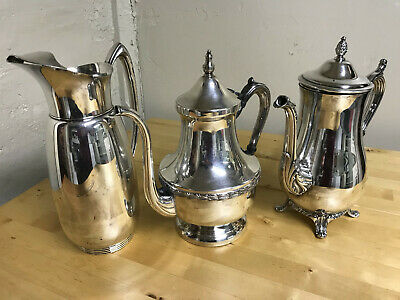Vintage lot of shining silverplate/silver on copper coffee and water pots