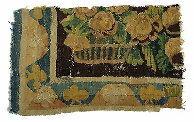 A Tapestry Fragment with Basket of Flowers