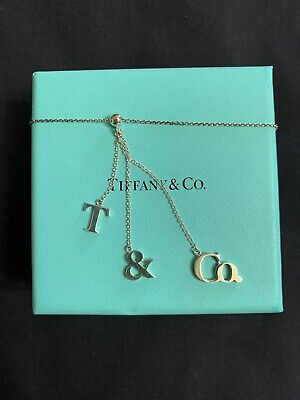 Tiffany & Co. Sterling Silver Dangling Dangle T & CO Letters Pendant Necklace