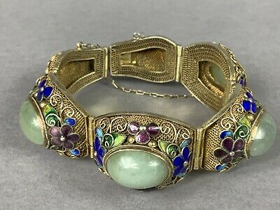 A Chinese Silver and Enamel Bracelet with Four Jade Stones