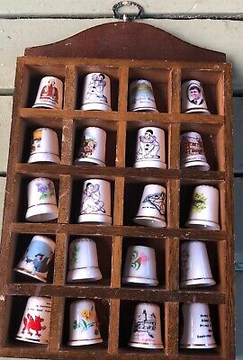 Collection of 20 thimbles in wooden display case
