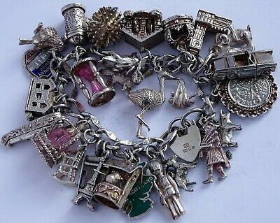 Amazing vintage solid silver charm bracelet & 27 charms, rare,open,move. 110.2g