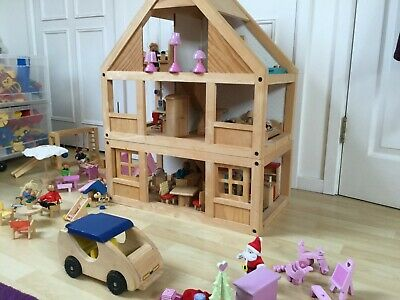 Wooden Dolls House (3 floors, Plan Toys) & over 100 items furniture and figures