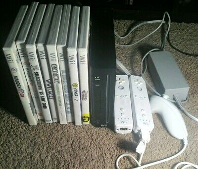 Nintendo Wii Black Console with 8 games 2 controllers +nunchuck