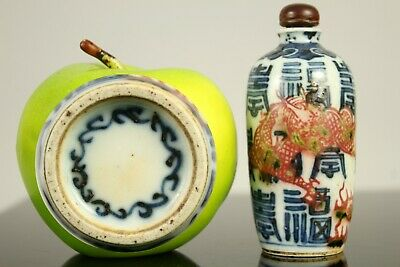 A Chinese underglaze red, blue & white dragon snuff bottle with dragon 19thc