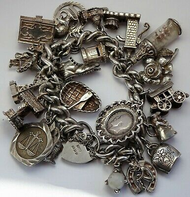 Amazing vintage solid silver charm bracelet & 24 charms, rare,open,move. 116.3g