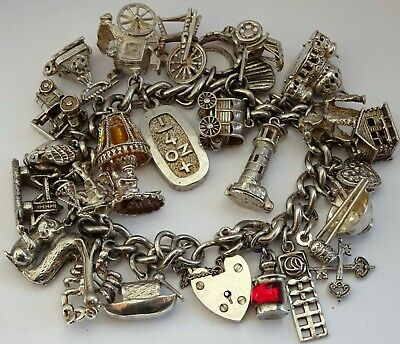 Wonderful vintage solid silver charm bracelet & 26 charms,rare,open,move. 113.8g