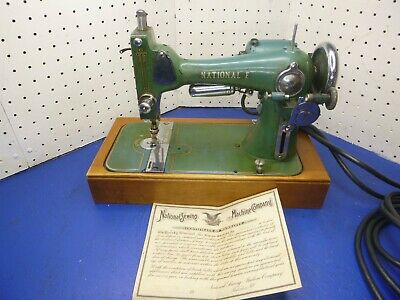 VINTAGE  National E Sewing Machine original certificate and extras