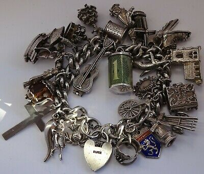 Stunning vintage solid silver charm bracelet & 27 charms,rare,open,move. 111.8g