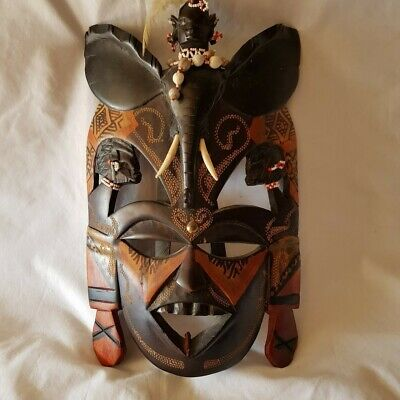 African Hand Carved Wooden Art Deco Face Mask with a carved elephant