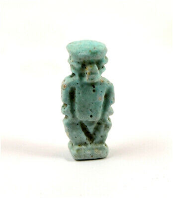 Egypt a blue-green glazed faience amulet of the dwarf Pataichos
