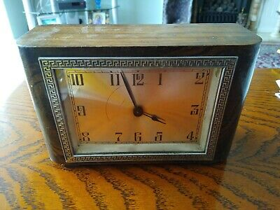 Art deco Wooden Cased Mantel Clock needs attention sometimes it will work .