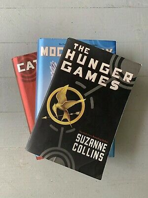 The Hunger Games Set by Suzanne Collins One Paperback Two Hardcovers