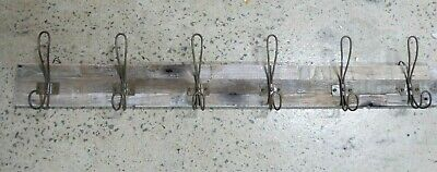 Vintage Antique Look Metal Wire Clothes Coat Hooks Mounted On Weathered Timber