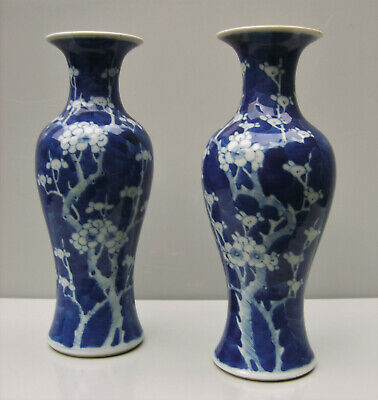Pair Chinese porcelain prunus painted blue and white vases Qing