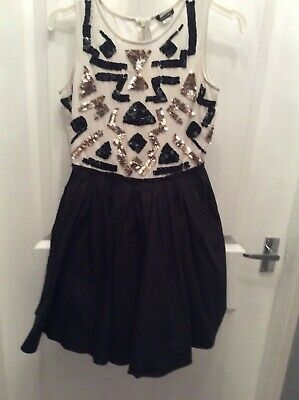 Girls black cream and gold. River island  sequinned. dress 11 yrs