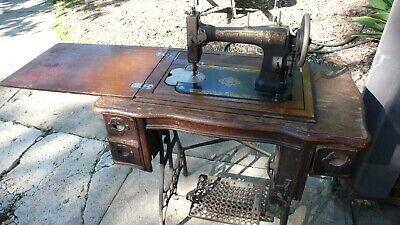 Antique White Sewing Machine with Treadle in Cabinet