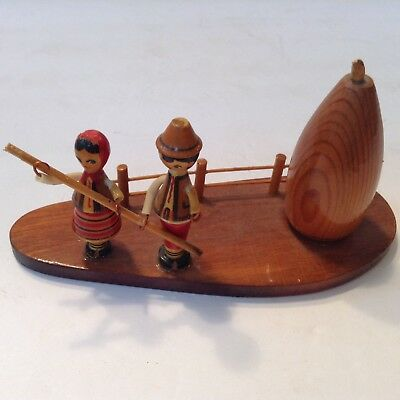 Vintage Carved  Hand Painted Russian Wooden Figures on raft -Movable Arms.