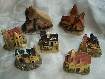 A Collection Of Approx Six Small Houses