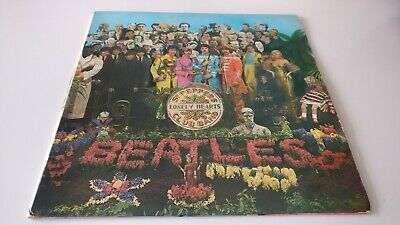 The Beatles Sgt Peppers Lonely Hearts Club Band LP First Press Complete.