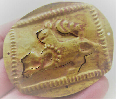 Ancient Near Eastern Gold Hammered Mount Depicting Beast, High Carat Gold