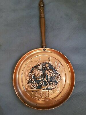 antique copper backing dish as a frying pan