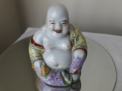 Pottery Buddha smiling figure hand painted and signed, looks to have good age