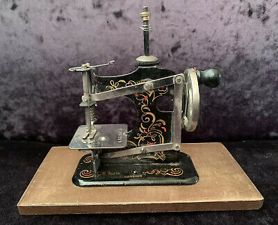 Antique German Muller No. 3 Toy Sewing Machine On Wooden Base
