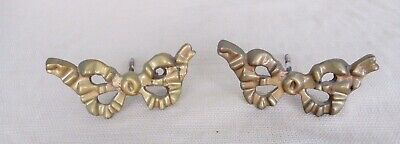 Great set of two antique brass bow shaped curtain tie backs