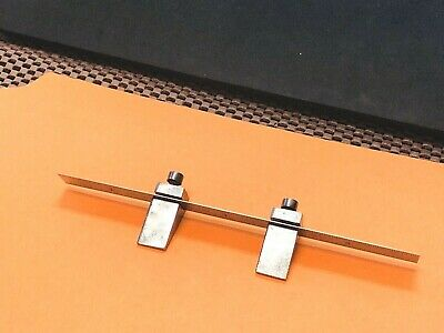 Vintage Key Seat Rule Clamps with a 6 Inch Long Craftsman Flexible Steel Ruler.