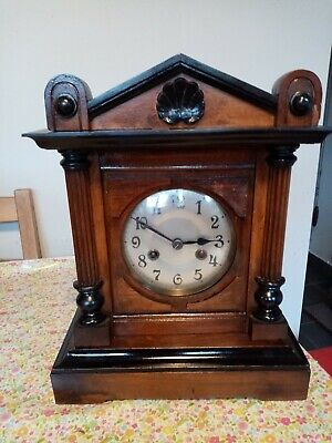 Antique  dark wood cased mantle clock with key & chimes - good & working