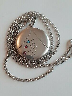 A Victorian Art Nouveau Silver Locket with turquoise ruby & pink sapphire