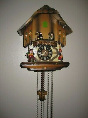 German Black Forest  Chalet Cuckoo clock with dancers and music