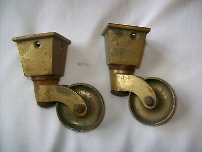** PAIR of VICTORIAN BRASS BOXED CASTORS **