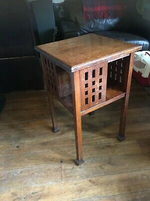 Arts crafts Glasgow style library table with book shelf oak